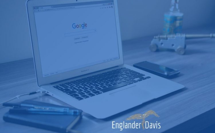 Header image. Macbook at desk with notebook and phone. Purple overlay and Englander Davis logo and text over the top of image.